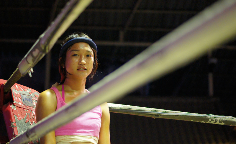 "A Thai girl stands in the corner prior to a Muay Thai fight/match in Chiang Mai, Thailand.  Travel photo from Chiang Mai, Thailand. <a href=""http://nomadicsamuel.com"">http://nomadicsamuel.com</a>"