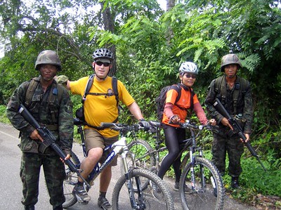 Scott & Nee pose with some Thai soldiers who were conducting some war games during our ride from Mae Salak to Chiang Rai.
