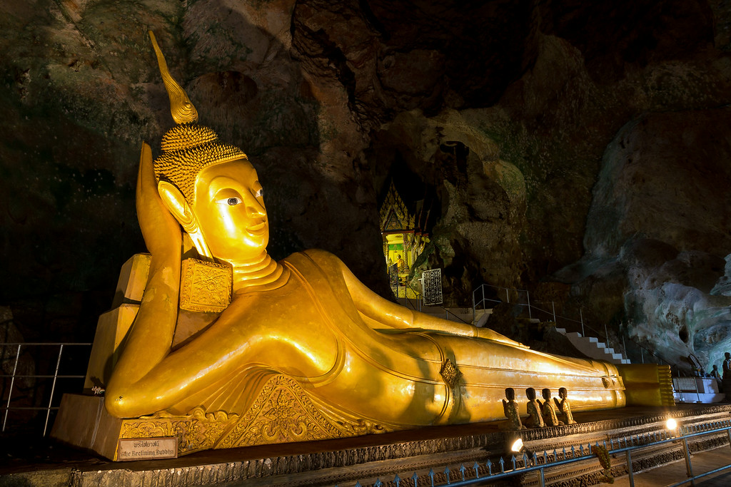 The 15 meter long Golden Reclining Buddha at Wat Suwannakuha Temple Cave, Phang Nga