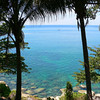 Roads circumscribe the entire island of Phuket. Viewpoints along their sides give vistas like this one near Patong Beach.