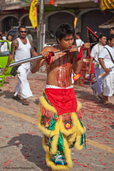 A Bang Neow Shrine Ma Song Participates In Morning Procession Through Phuket Town - Blood Flowing Down His Chest From Self Mortification of His Tongue with A Sword