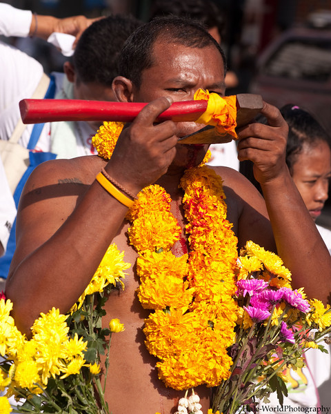 A Bang Neow Shrine Ma Song Participates In Morning Procession Through Phuket Town - Blood Flowing Down His Chest From Self Mortification of His Tongue with an Axe