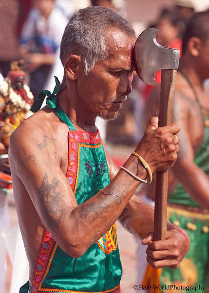 A Bang Neow Shrine Ma Song Participates In Morning Procession Through Phuket Town - Blood Flowing From Self Mortification of His Head with An Axe