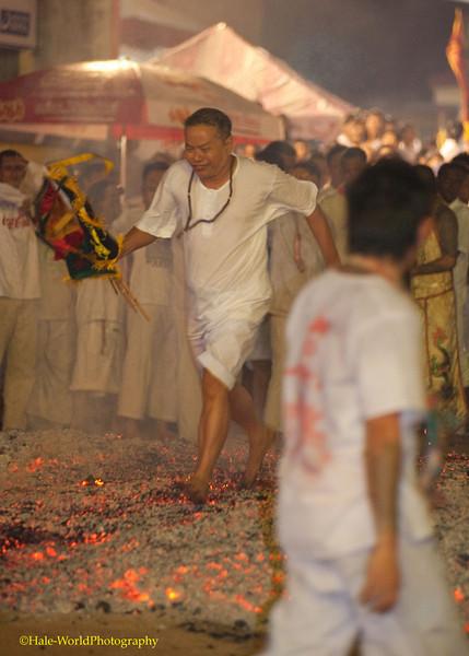 A Devotee Fire Walks at Ban Neouw Shrine