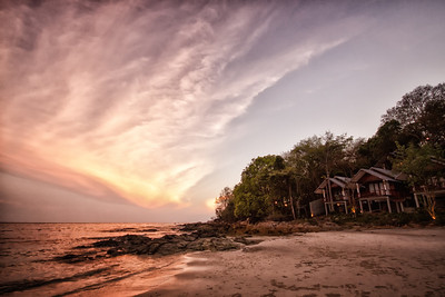 Private bungalows during sunset on Koh Samet island in Thailand.
