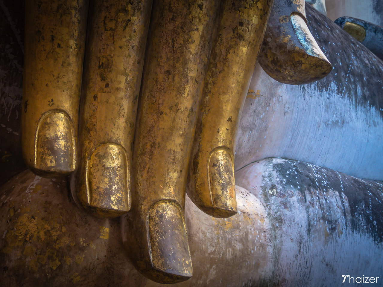 gold-leaf on fingers of Phra Achana at Wat Si Chum in Sukhothai