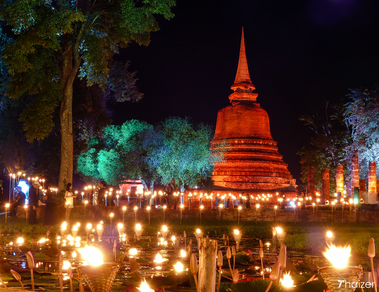 lights and chedi during Loy Krathong at Sukhothai Historical Park