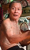 Tattooed man at the Damnoensaduak Floating Market outside Bangkok in October 2008