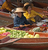 Vendors at the Damnoensaduak Floating Market outside Bangkok in October 2008