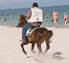 A volunteer policeman petrolling the beach on a horse at Hua Hin, October 2008