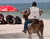 A volunteer policeman patrolling the beach on a horse at Hua Hin, October 2008