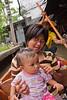 Women and baby at the Damnoensaduak Floating Market in Thailand, taken in October 2008