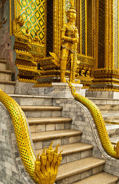 Architectural detail with gold figures at the Grand Palace in Bangkok, Thailand, Asia.