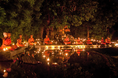 Young monks meditating during Visakha Bucha in Chiang Mai, Thailand.