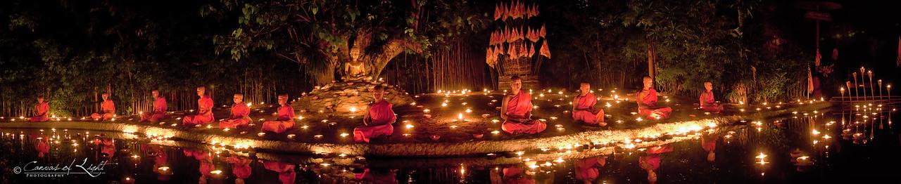A panoramic shot of young monks meditating during Visakha Bucha in Chiang Mai, Thailand