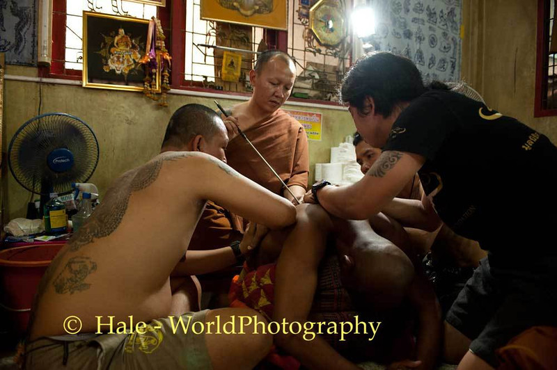 Luang Pi Nunn Applies A Sak Yant On A Devotee