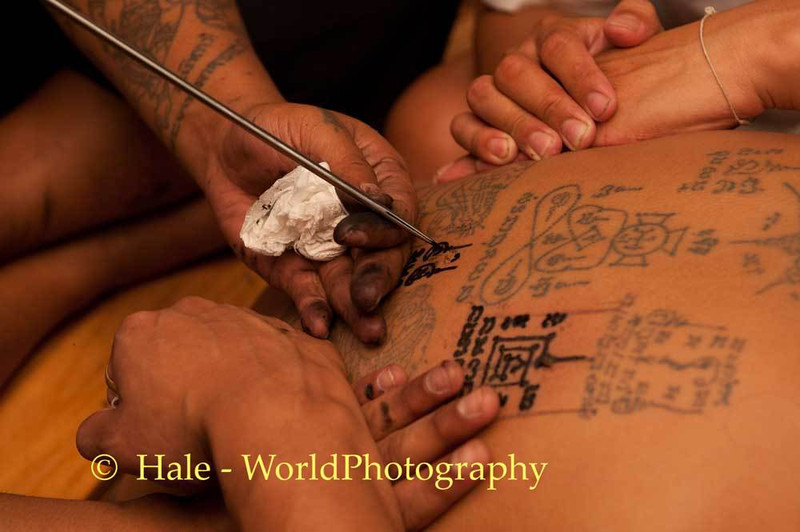 Sak Yant Tattoo Being Applied At Wat Bang Phra