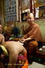 Luang Pi Nunn Tattooing A Devotee