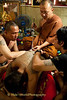 Luang Pi Nunn Applies A Sak Yant Tattoo On A Devotee At Wat Bang Phra