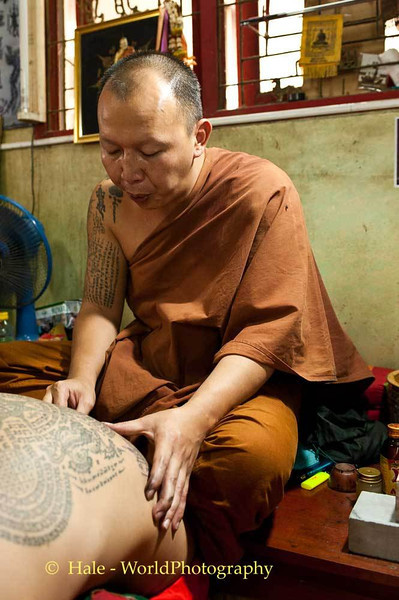 Luang Pi Nunn Energizes the Tattoo That He Has Just Finished