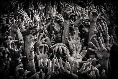 Hands reaching out from Hell at Wat Rong Khun, the White Temple in Chiang Rai, Thailand.