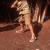 Akha boy spins homemade top, Mai Salong area, Thailand