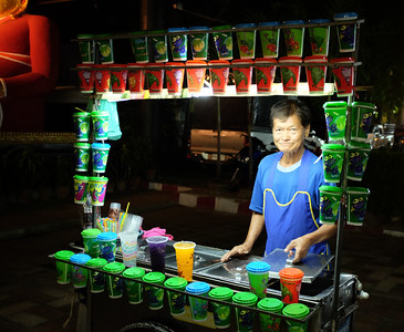 Selling sweet colorful drinks at a food cart in Chiang Mai, Thailand.