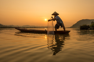 Readying His Net, Fisherman on the Mekong River, Thailand