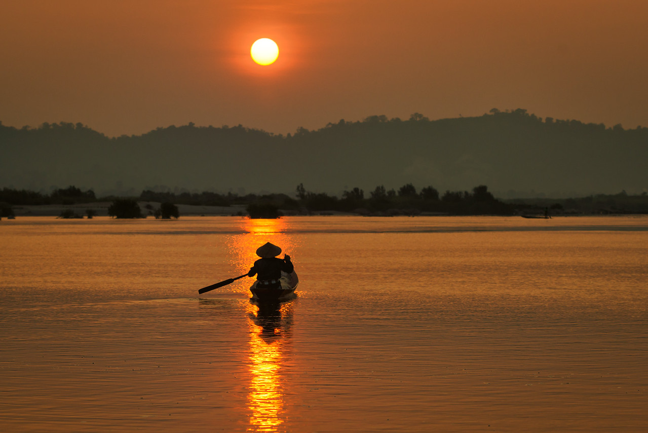 Into the Sun, Fisherman on the Mekong River, Thailand