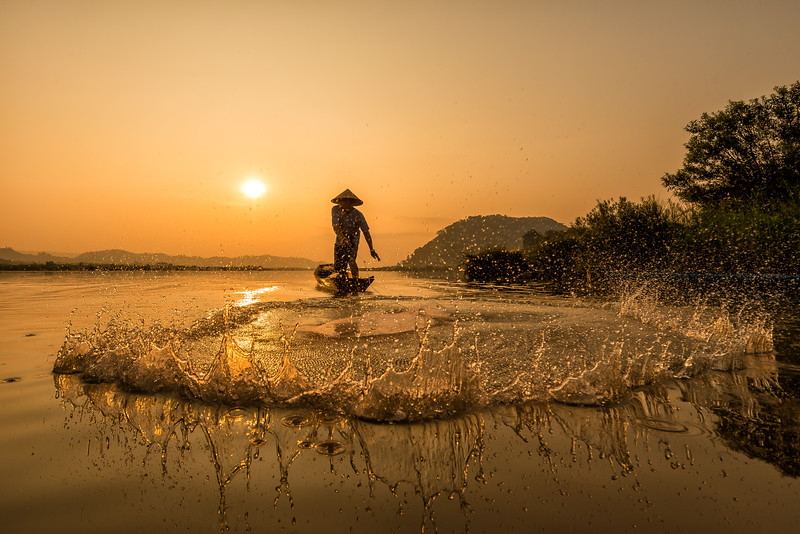 Fishing at Sunrise along the Mekong River