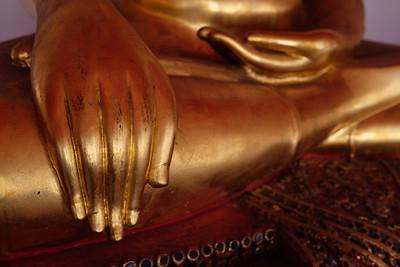 Buddha hands (mudras) of a statue.  Thailand.