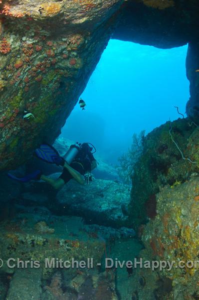 Swimthrough between the boulders at Elephant Head Rock, Similan Islands, Thailand