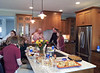 Alex, Megan, Claire, Pat, Bill, Carly, in the kitchen, snacking before dinner.   Super high ceilings and an open kitchen/dining-room plan make this a great room for socializing