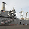 A victory ship.  100 feet longer than a liberty ship.  Liberty ships did 8 knots (stean piston powered, slower than a submerged U-boat), victory ships did 13 knots (turbine powered, faster than a submerged U-boat)