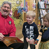 Fitchburg Mayor Stephen DiNatale read the book A Charlie Brown Thanksgiving at the Thanksgiving rivalry fundraiser held at Barnes & Noble in Leominster on Saturday, Nov. 23, 2019. On stage with him is Colin Sproules, 5, and Ava Mayes, 5. SENTINEL & ENTERPRISE/JOHN LOVE