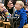 Colin Sproules, 5, listens to Leominster Mayor Dean Mazzarella as he reads the book Dragons Love Tacos at the Thanksgiving rivalry fundraiser held at Barnes & Noble in Leominster on Saturday, Nov. 23, 2019. SENTINEL & ENTERPRISE/JOHN LOVE