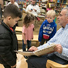 Leominster Mayor Dean Mazzarella read the book Dragons Love Tacos at the Thanksgiving rivalry fundraiser held at Barnes & Noble in Leominster on Saturday, Nov. 23, 2019. On Stage with him is Miles Caissie, 7, and Colin Sproules, 5, on right. SENTINEL & ENTERPRISE/JOHN LOVE