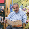 Leominster Mayor Dean Mazzarella read the book Dragons Love Tacos at the Thanksgiving rivalry fundraiser held at Barnes & Noble in Leominster on Saturday, Nov. 23, 2019. SENTINEL & ENTERPRISE/JOHN LOVE
