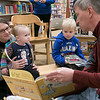 Fitchburg Superintendent Robert Jokela reads a book to Caralabbe Labbe her daughter Amelia Labbe, 1, and Colin Sproules, 5, at the Thanksgiving rivalry fundraiser held at Barnes & Noble in Leominster on Saturday, Nov. 23, 2019. SENTINEL & ENTERPRISE/JOHN LOVE
