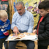 Leominster Mayor Dean Mazzarella read the book Dragons Love Tacos at the Thanksgiving rivalry fundraiser held at Barnes & Noble in Leominster on Saturday, Nov. 23, 2019. On Stage with him is Miles Caissie, 7, and Colin Sproules, 5, on left. SENTINEL & ENTERPRISE/JOHN LOVE