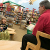 Fitchburg Mayor Stephen DiNatale read the book A Charlie Brown Thanksgiving at the Thanksgiving rivalry fundraiser held at Barnes & Noble in Leominster on Saturday, Nov. 23, 2019. Listening in the audience is Ava Mayes, 5, of Leominster. SENTINEL & ENTERPRISE/JOHN LOVE
