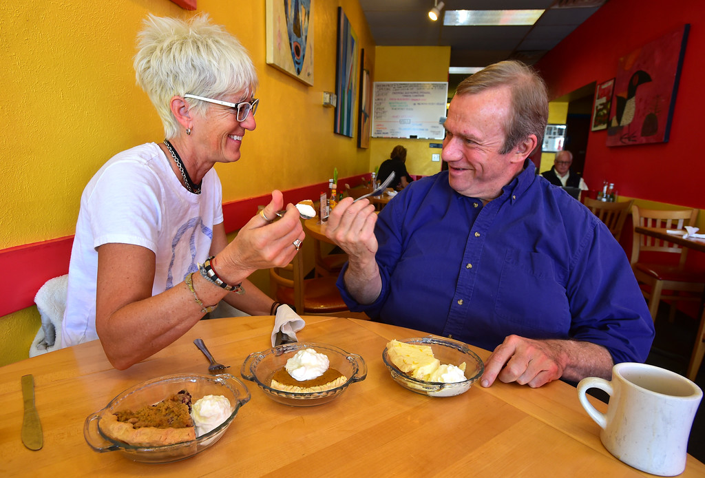 . Walnut Cafe Owner Dana Derichsweiler tastes pie with author John Lehndorff at the Walnut Cafe in Boulder on Monday. Pies from left to right Blueberry Peach Crumb, Pumpkin Pie and Ray\'s Lemon Cream Pie at right.  Paul Aiken Staff Photographer Nov 13, 2017