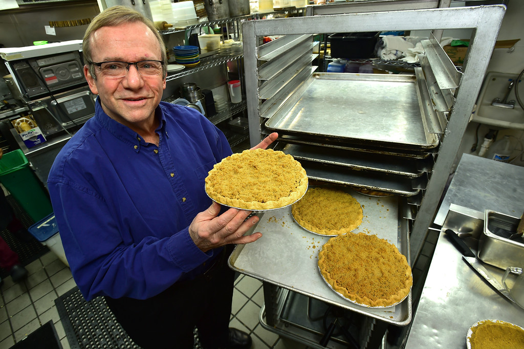 . John Lehndorff with an Apple Cranberry Crumb Top Pie that is cooling off in the kitchen at the Walnut Cafe in Boulder on Monday. Paul Aiken Staff Photographer Nov 13, 2017