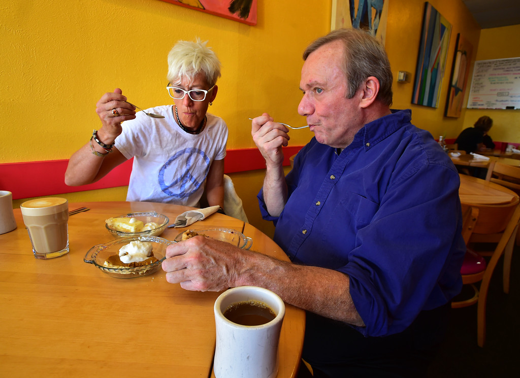 . Walnut Cafe Owner Dana Derichsweiler tastes pie with author John Lehndorff at the Walnut Cafe in Boulder on Monday. Pies are Blueberry Peach Crumb, Pumpkin Pie and Ray\'s Lemon Cream Pie. Paul Aiken Staff Photographer Nov 13, 2017