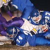 11/27/02 : Nashoba Tech Football : Westford- Nashoba Tech Thanksgiving Eve  football action vs Monty Tech, Wednesday night at Nashoba Tech; Nashoba Tech defenders #74 Kevin Corr, #44 Nick Simard, and #37 Cody Hoffman scramble for this loose ball in 1st half action vs Monty Tech. Sun Photo bob Whitaker/DIGITAL IMAGE