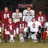 11/21/02 : Lowell HS Turkey Tab :  Lowell- LHS Defense, frt, l-r;  Paul McNeil, James McNeil, Claudius Zorokong, Joe Fuller, Larry Wilson. Rear, l-r; Andy Lattanasack, Joel Bartlett, Nick Dokos, Wil Colon, David Sylvester, Pat Sheehan .   Sun Photo Bob Whitaker/DIGITAL IMAGE