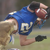 11/24/04-acton v westford turkey: Acton Boxboro vs Westford Thanksgiving day football game at Acton Boxboro high School . AB #24 Bobby Abare catches pass during game action. photo by Tory germann digital image4997