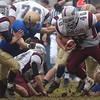 11/24/04-acton v westford turkey: Acton Boxboro vs Westford Thanksgiving day football game at Acton Boxboro high School .left to right : AB #8 Andrew Sides tries to stop Westford #40 Ryan Canty during game action.  photo by Tory germann digital image4997