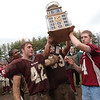 11/24/04-lowell v haverhill turkey: lowell v haverhill at cawley stadium. left to right : lowell Capt. Eustace Conjoh ,  #42 Nick Dokos, #53 Tim Sweet and #4 Jim Dillon  hold Riddick ryan trophy after win over haverhill. photo by Tory Germann digital image 4998