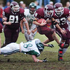 11/25/04- Chelmsford Billerica Football played at Chelmsford High  Chelmsford`s Bobby Gill hurdles Billerica`s Pat Abrahamson as he goes up the middle. #81Sam Reynolds and #33 D.J. Butler.  Sun photo by Michael Pigeon#5003